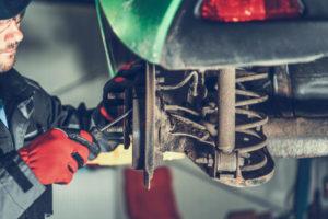 Auto Mechanic Servicing Brakes